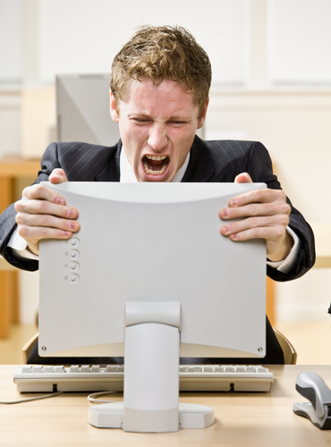 Businessman shouting at computer